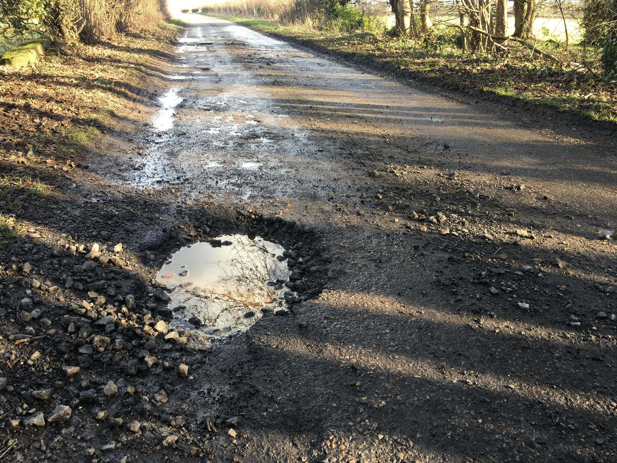 potholes along Scorcher Hills Lane